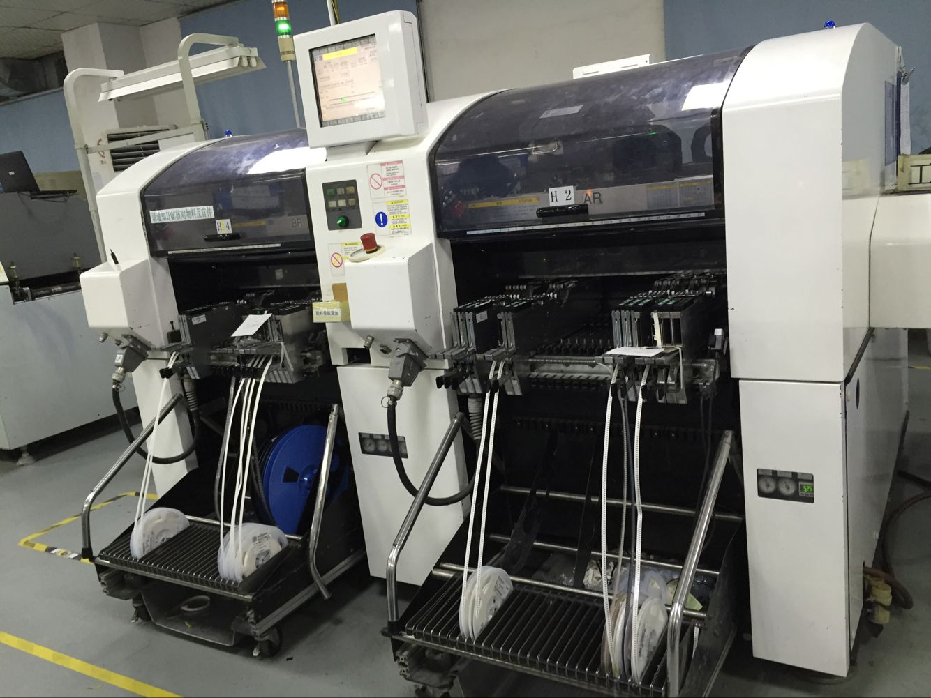 High-speed pick-and-play SMT machines in our SMT workshop